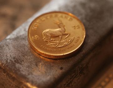 Silberbarren mit Goldmünze
